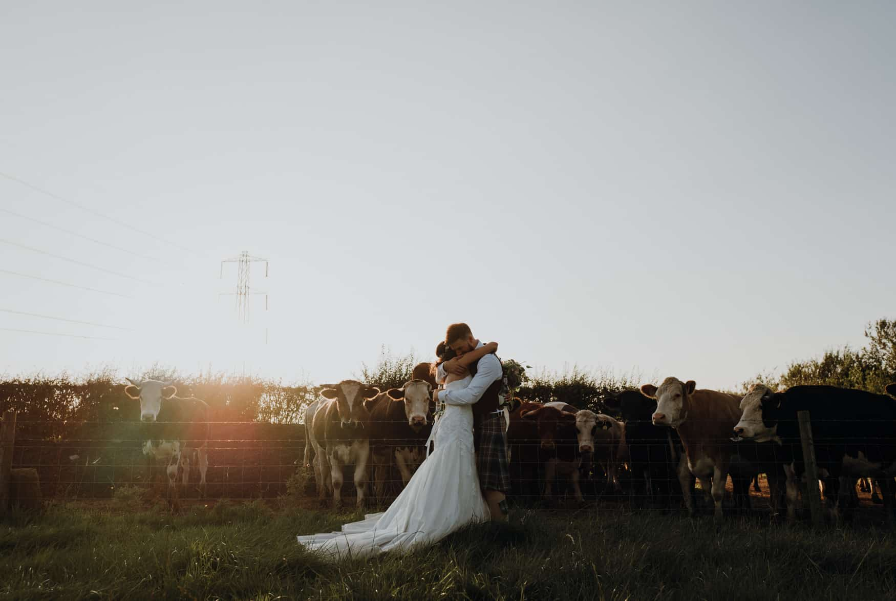 Bride and groom in a sunlit field