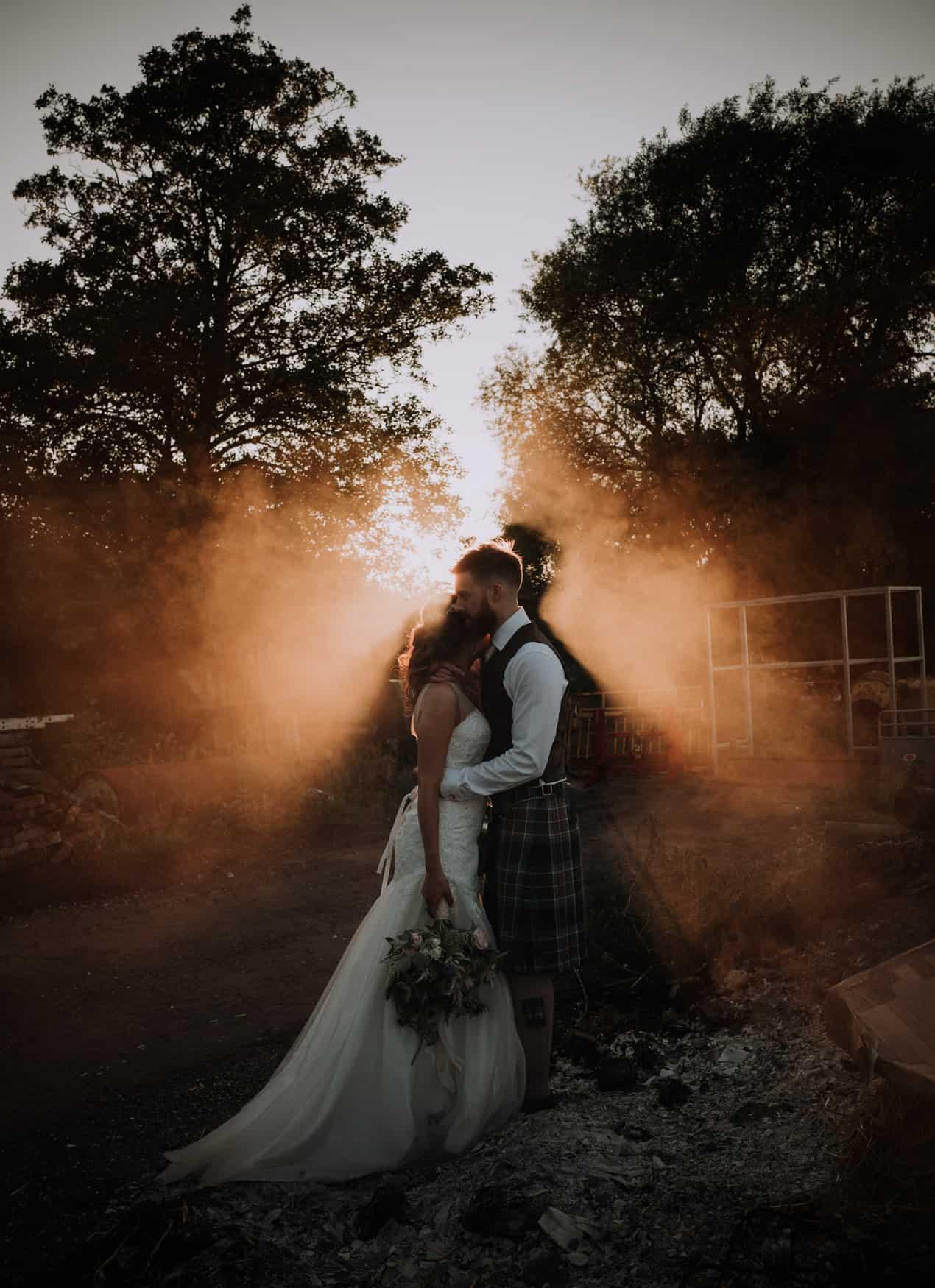 backlit Bride and groom