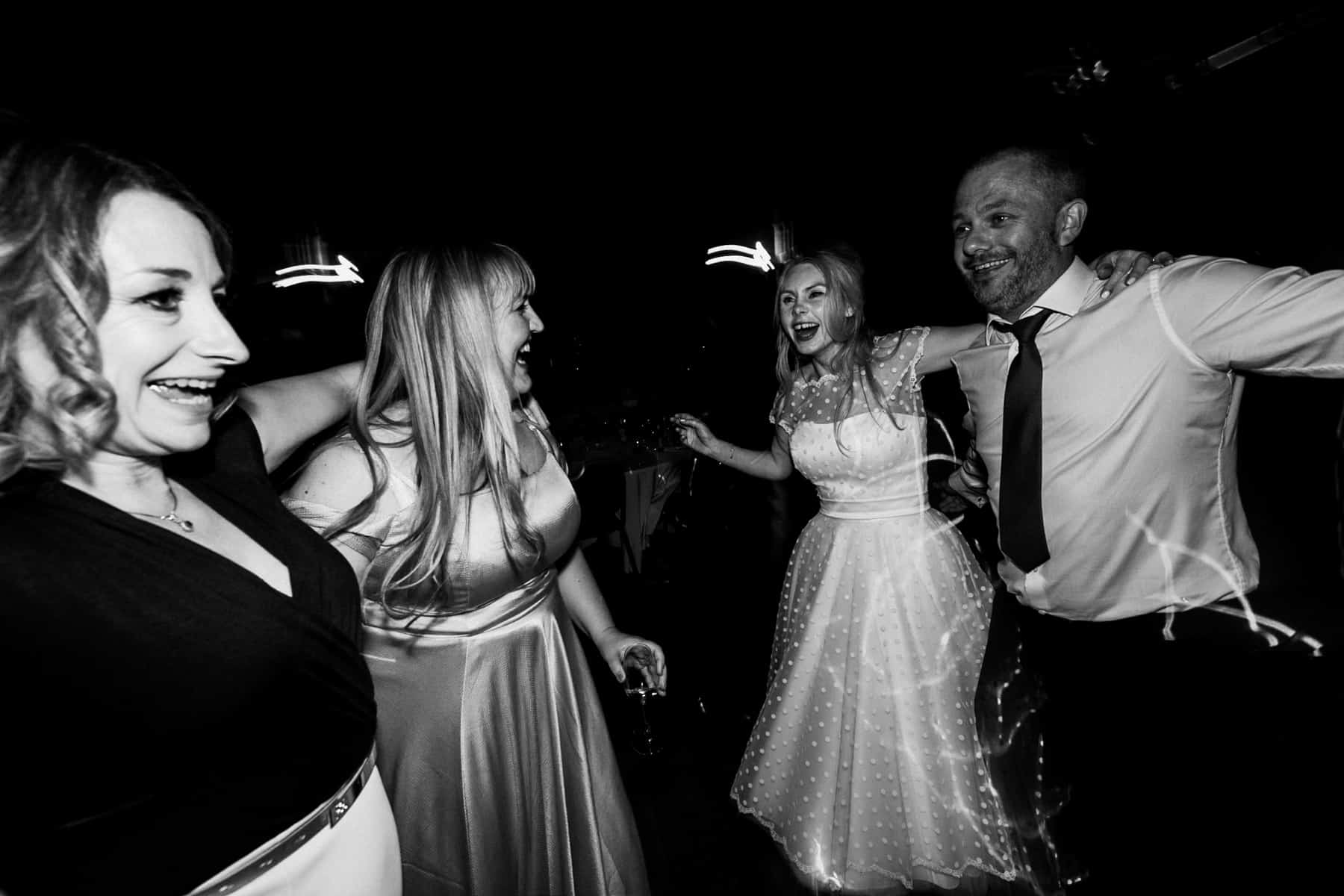 friends dancing with the bride and groom