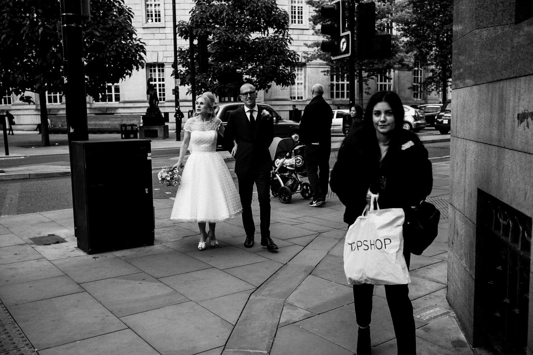 bride and groom in manchester city centre