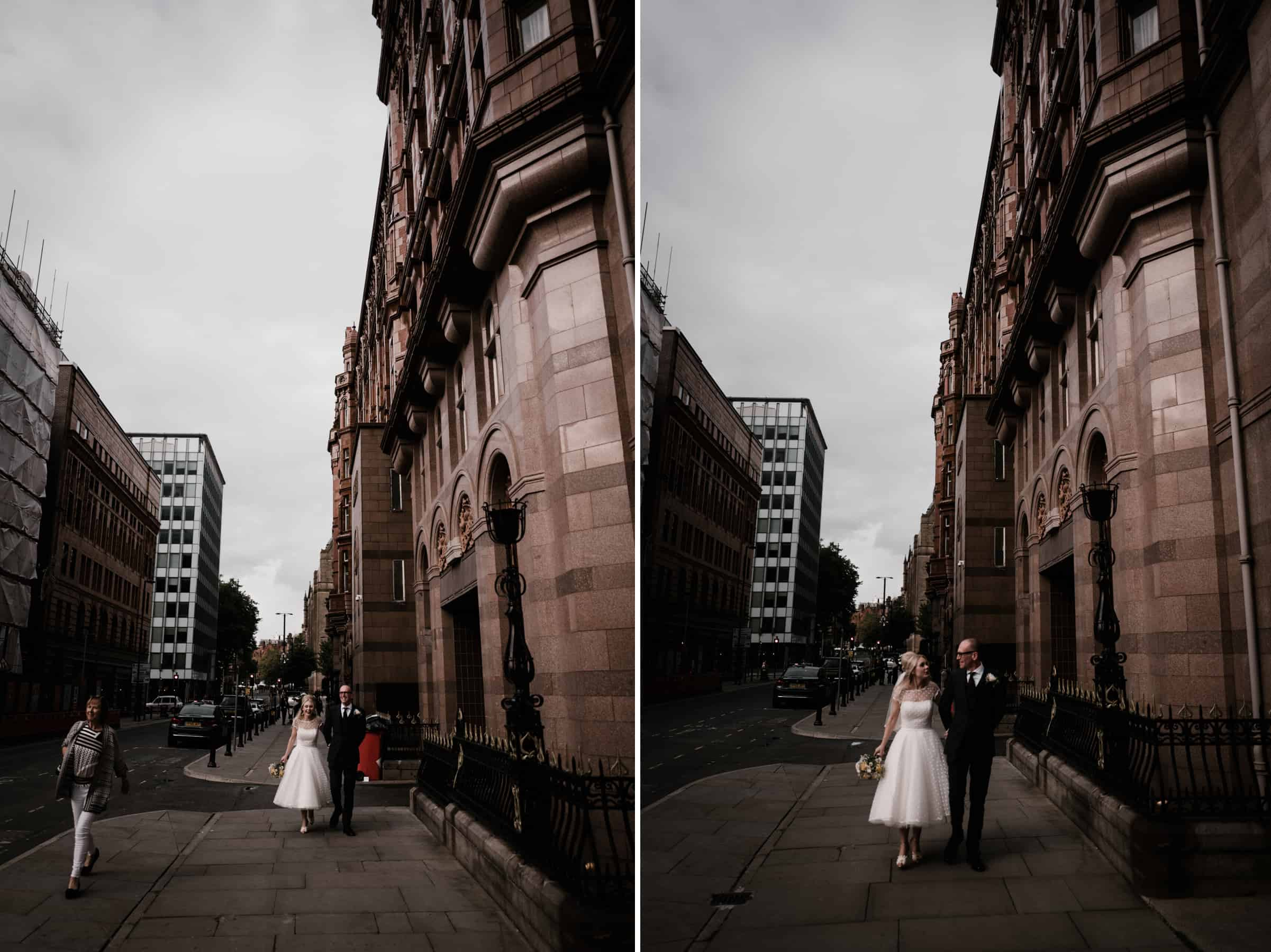 bride and groom walking through the city of manchester