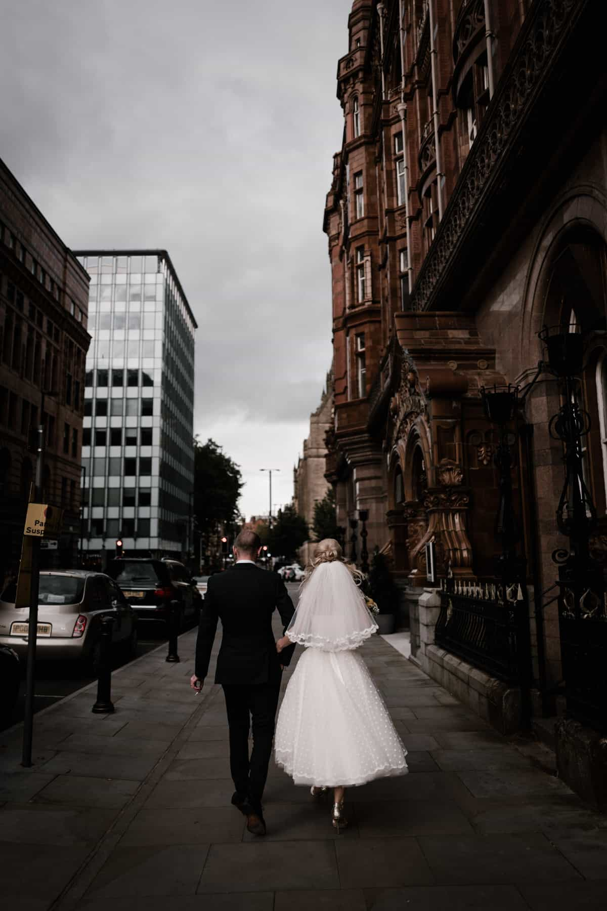 Bride and groom portrait near the Midland hotel