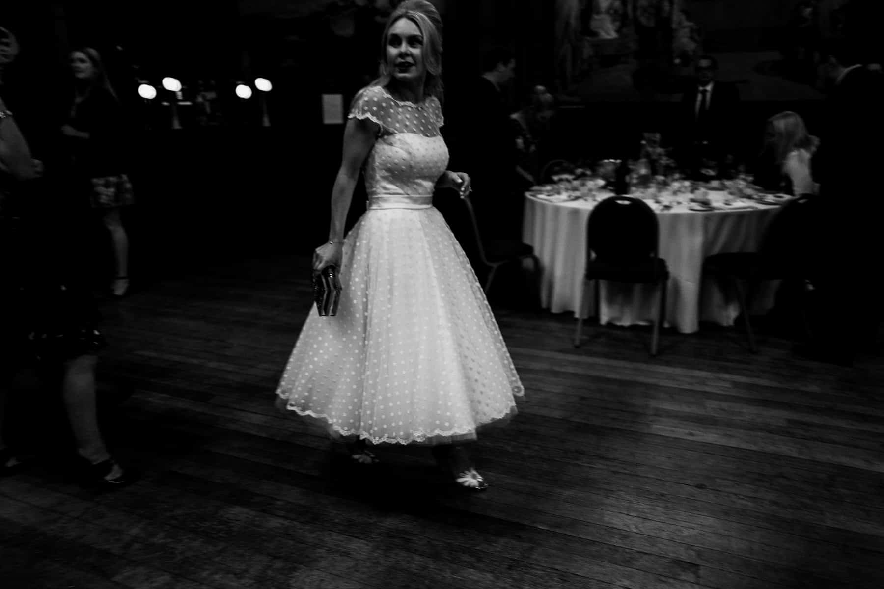 bride walking in black and white