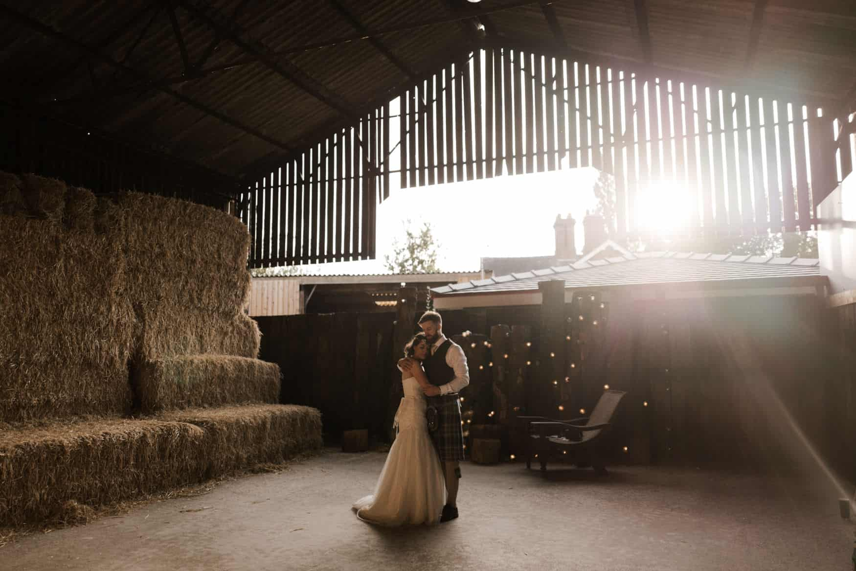 bride and groom portrait in some beautiful golden light at Owen House wedding barn