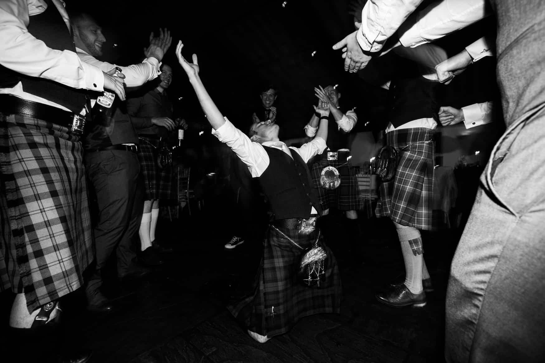 groomsmen on the floor dancing