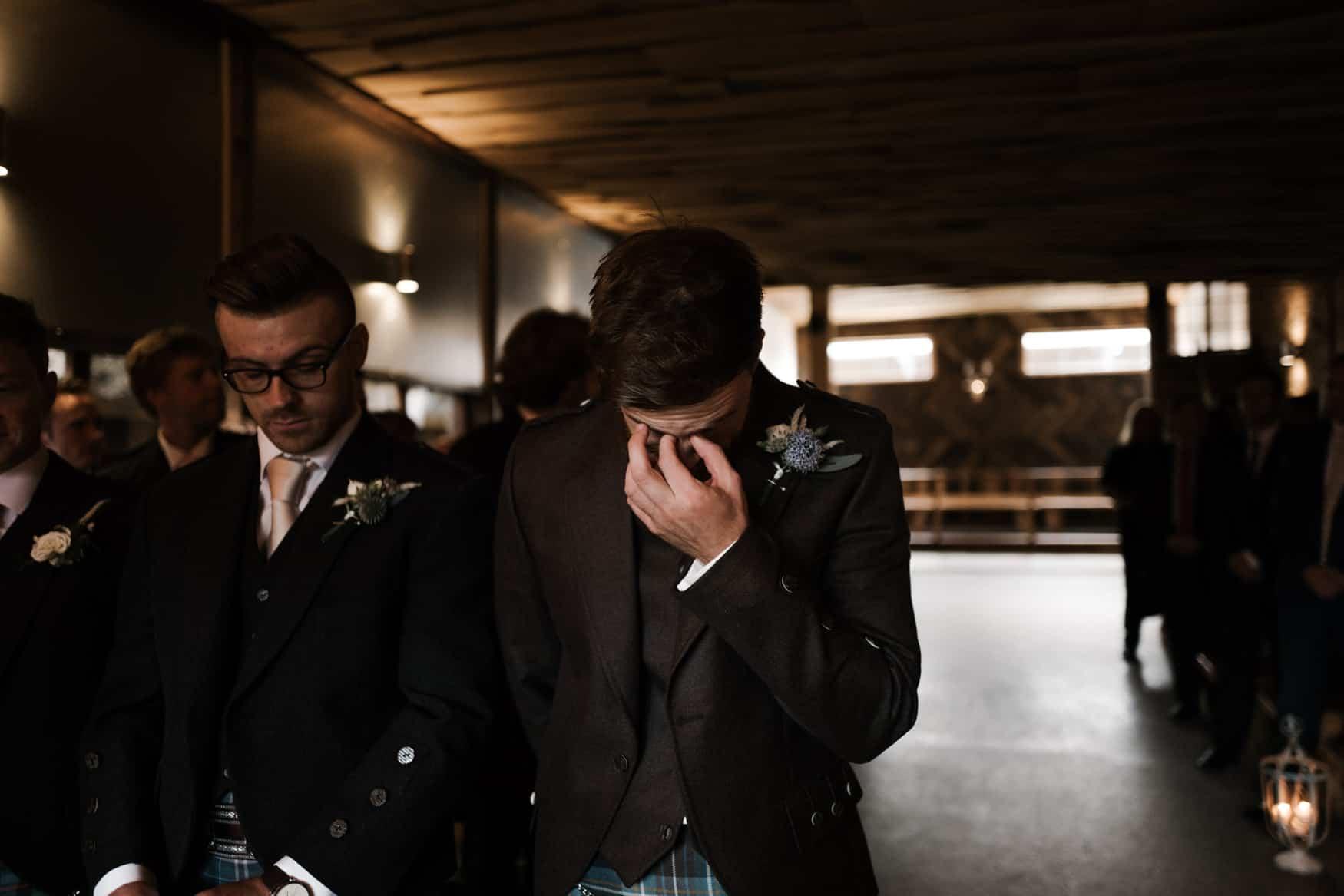 Groom waiting for bride in tears