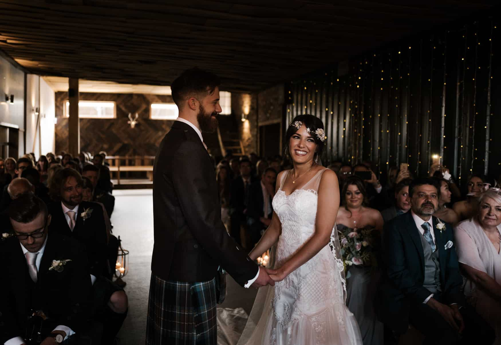 bride and groom laughter at Owen House wedding barn