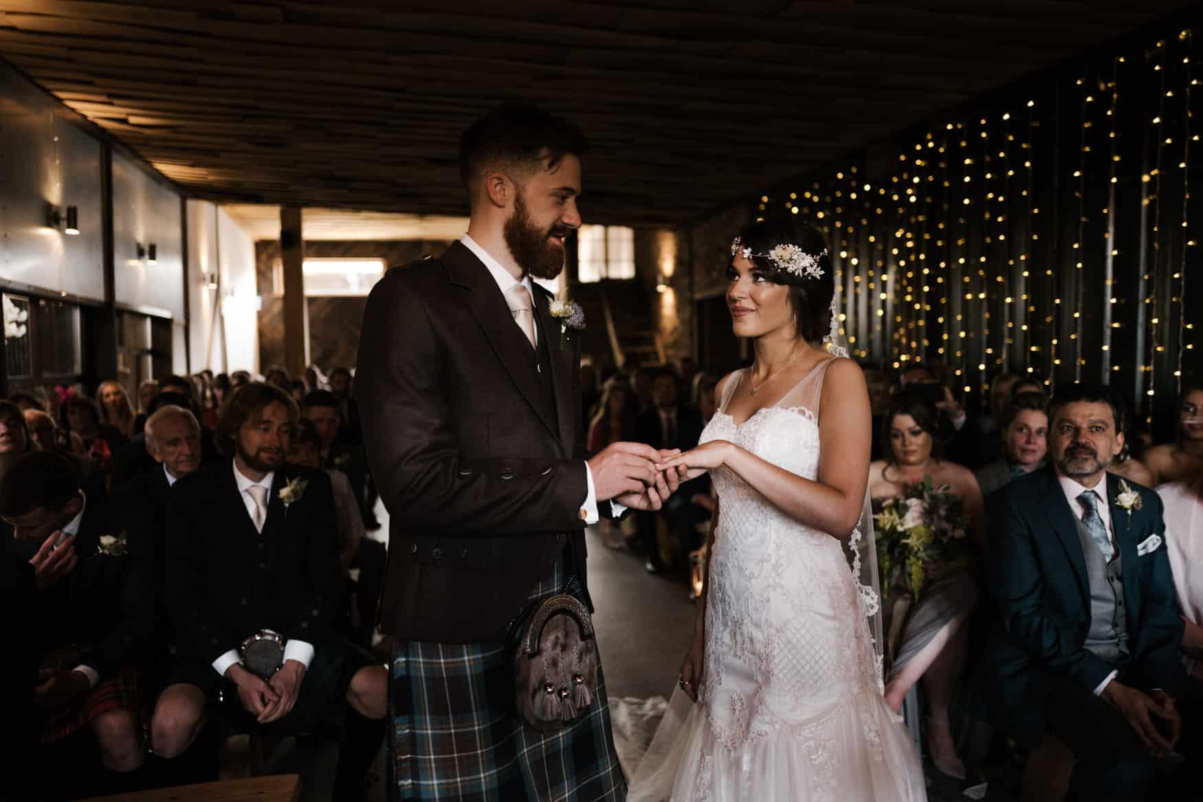 bride and groom swap rings