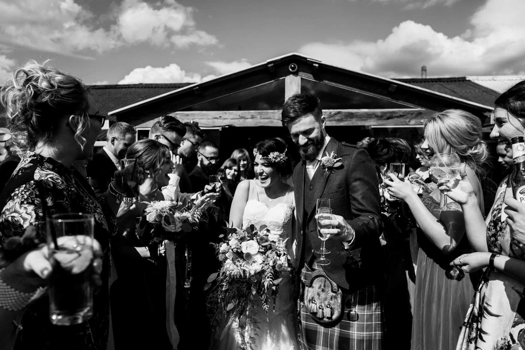 bride and groom confetti walk at Owen House Wedding barn