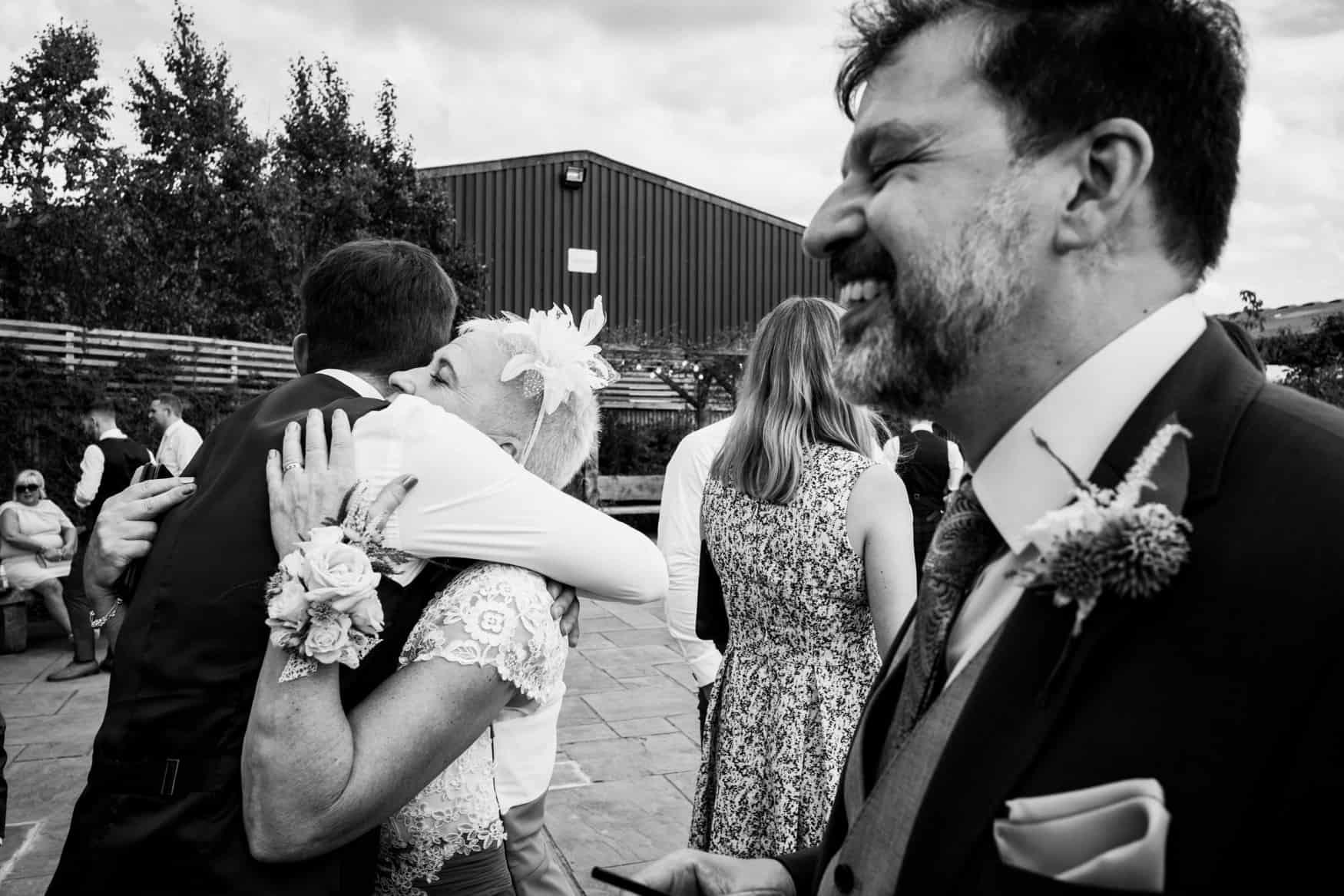 wedding party hugging