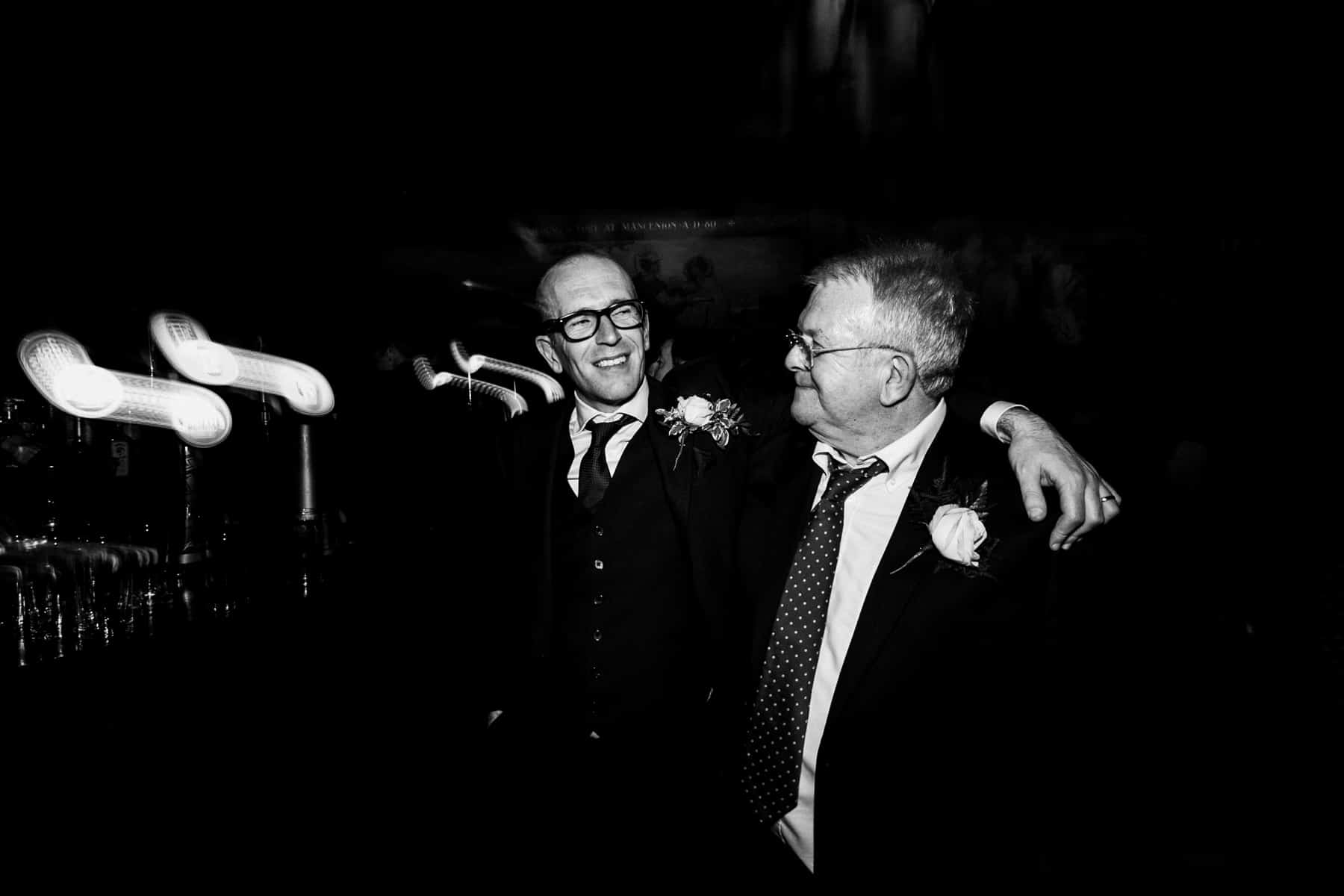 groom and father share a drink