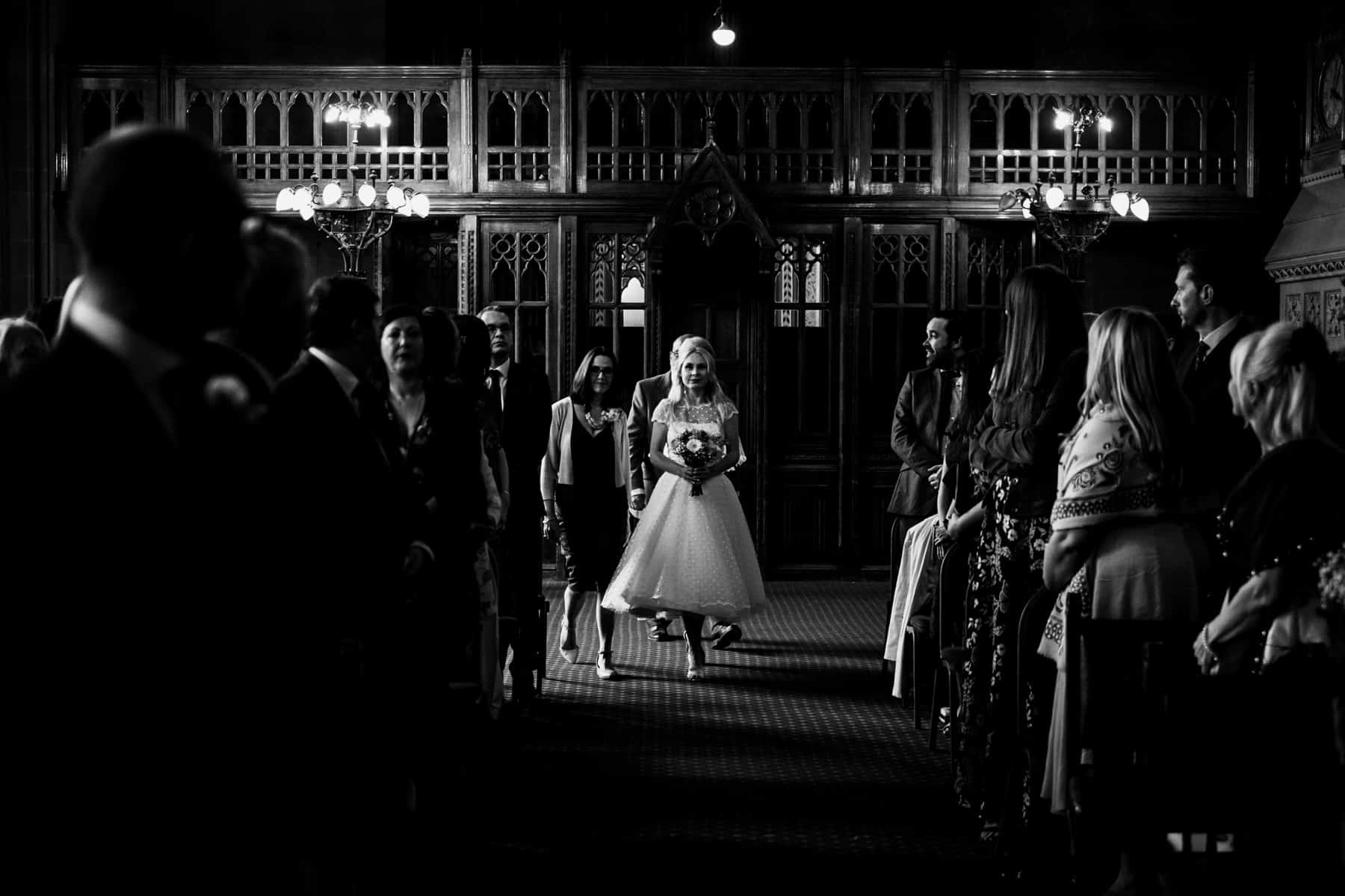 bride walks down the aisle at manchester Town hall