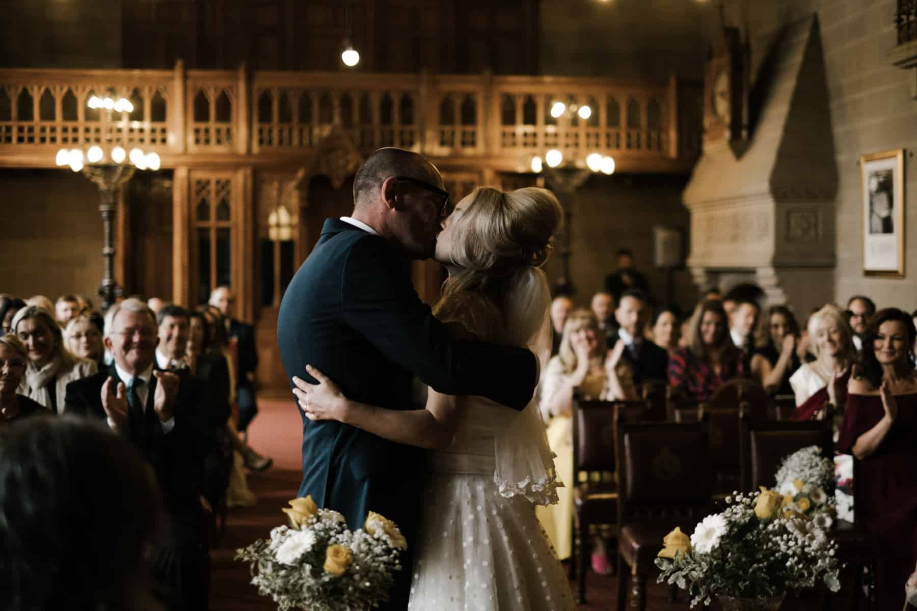 Bride and groom first kiss at manchester town hall