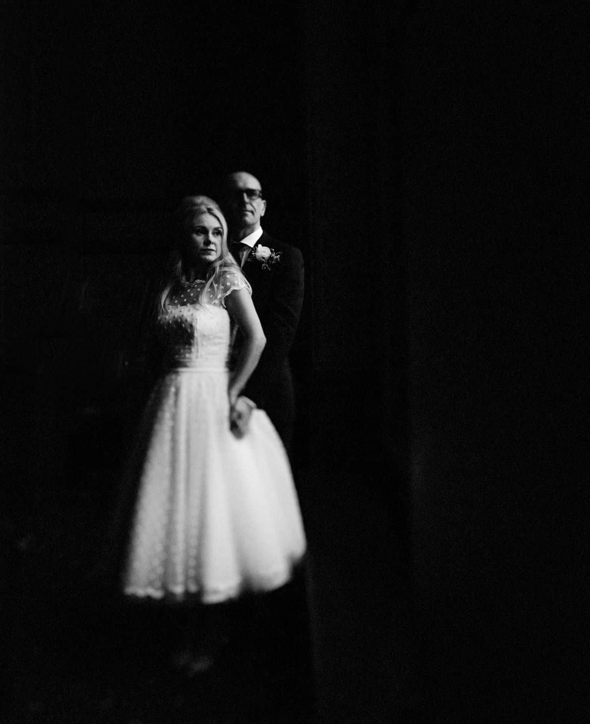 bride and groom black and white portraits at the town hall