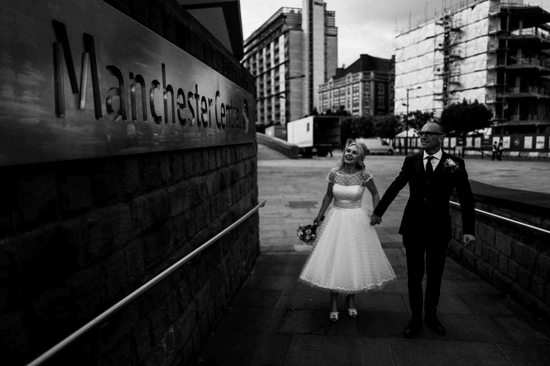 bride and groom at the GMEX building