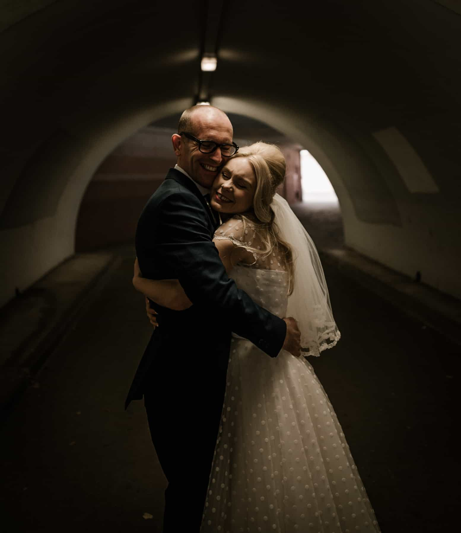 bride and groom in a tunnel