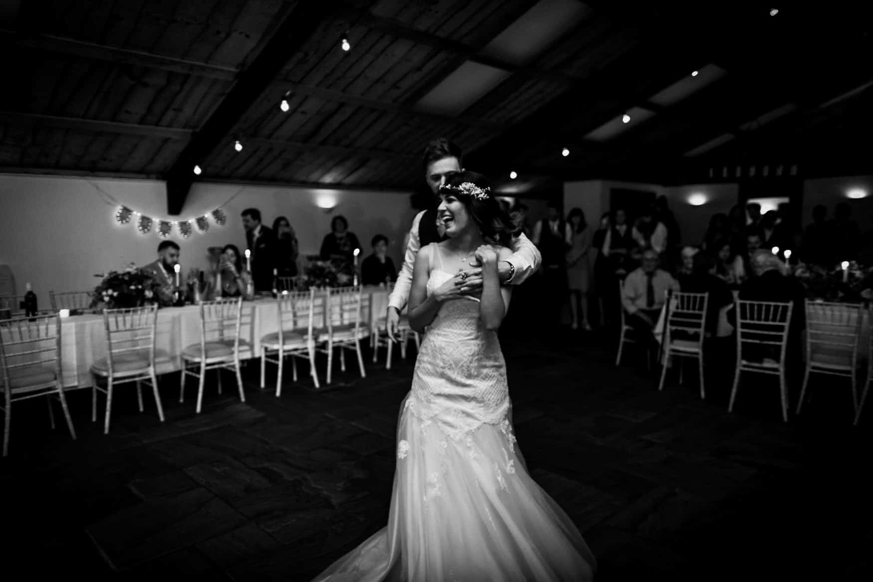 Bride and groom laugh during first dance