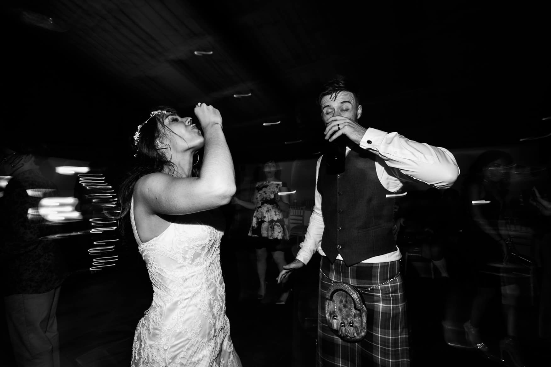 bride and groom do tequila shots