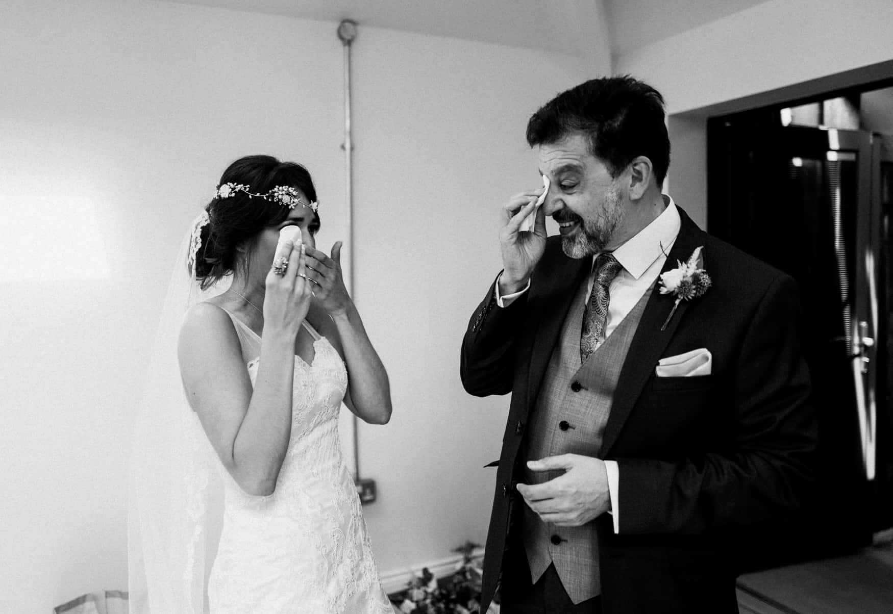 bride and father with emotional tears