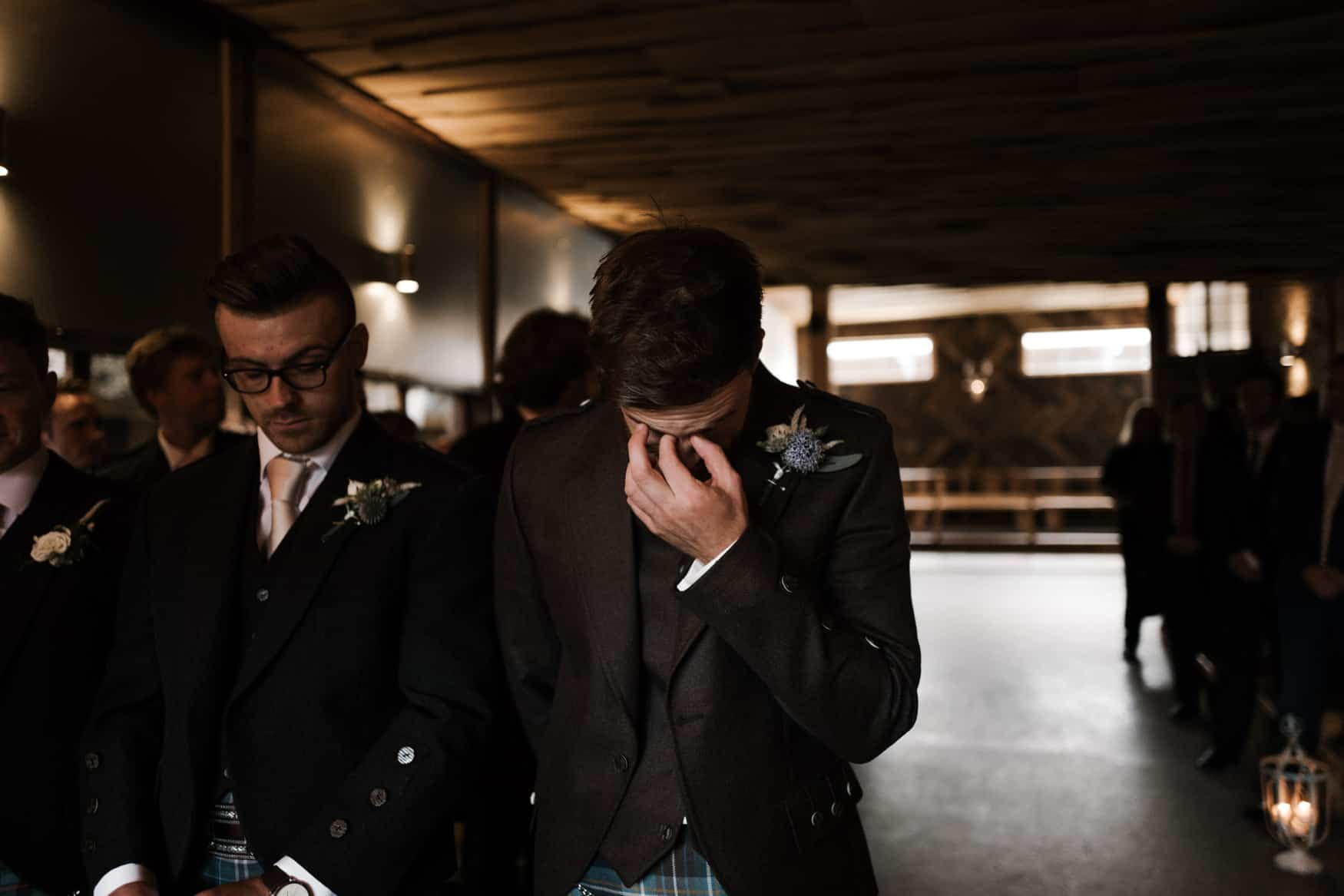 Groom waiting for bride in tears