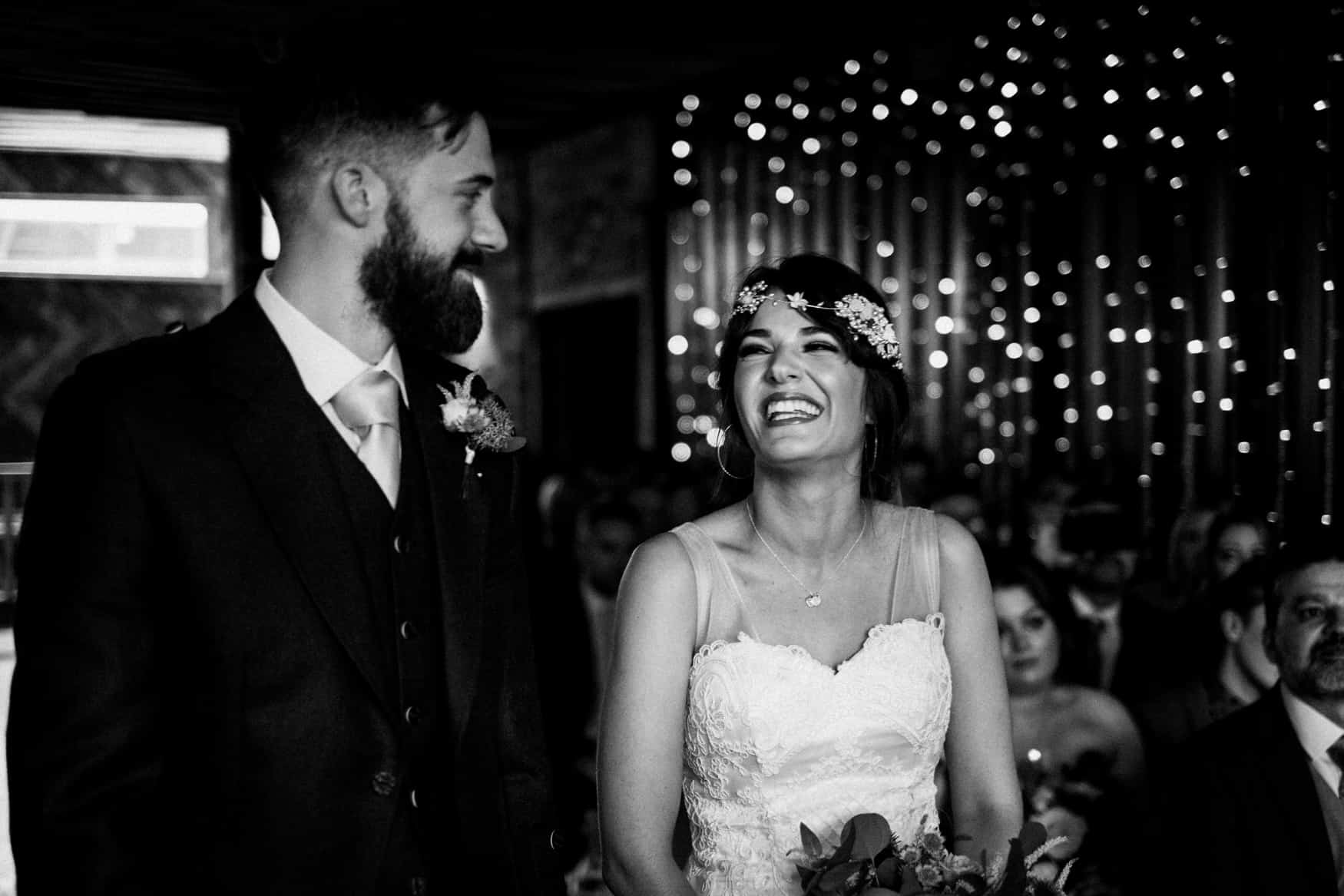 bride and groom laughter during wedding