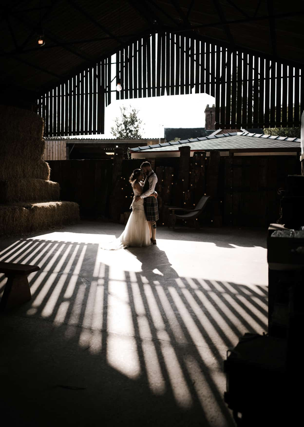 Bride and groom portrait at Owen House Wedding Barn in good light