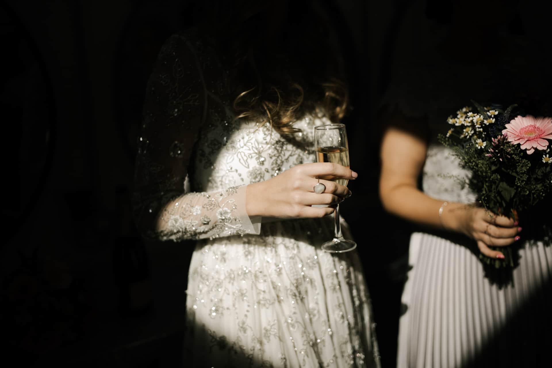 Bride holding champagne flute