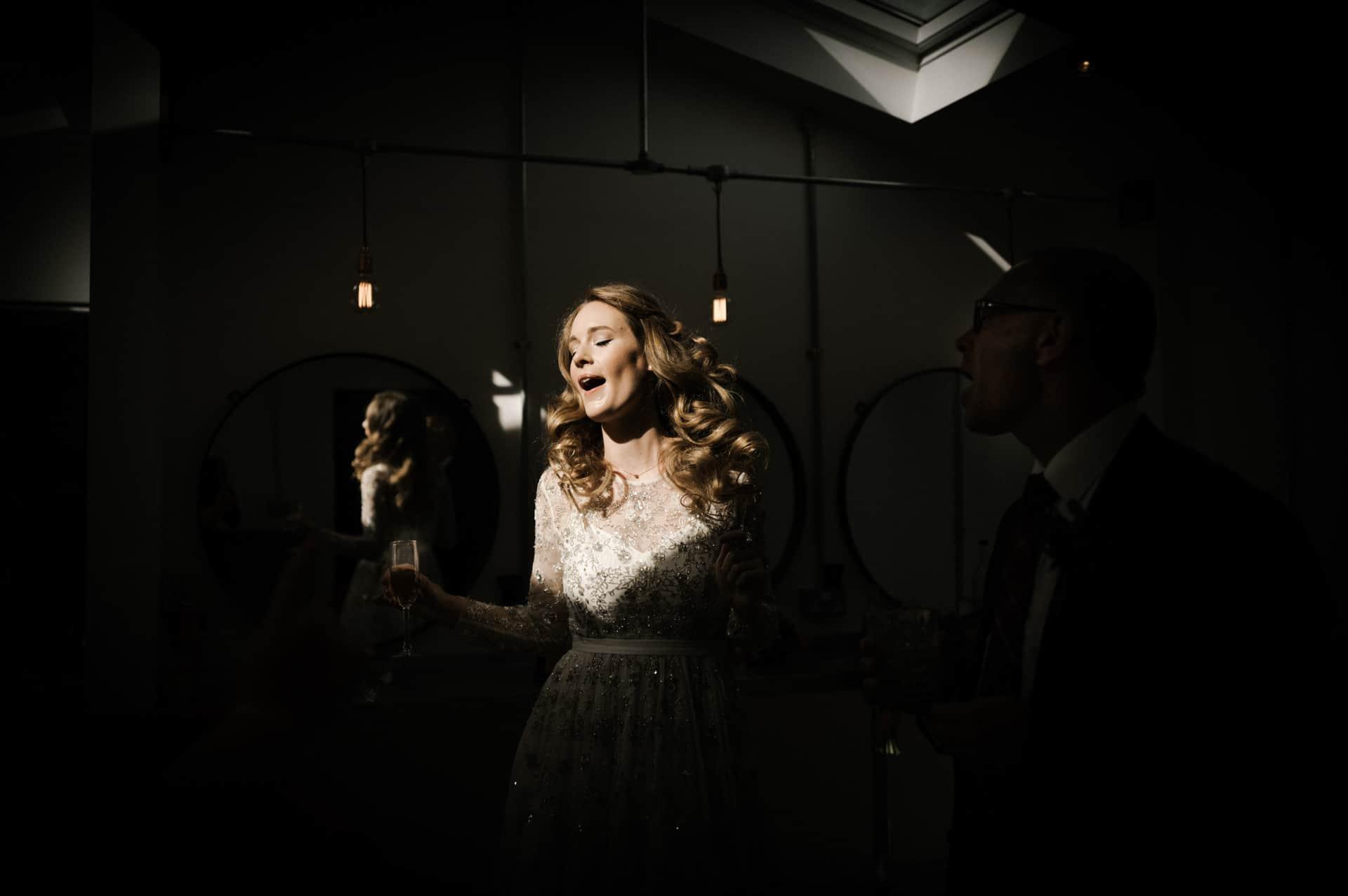 Bride dancing in the light