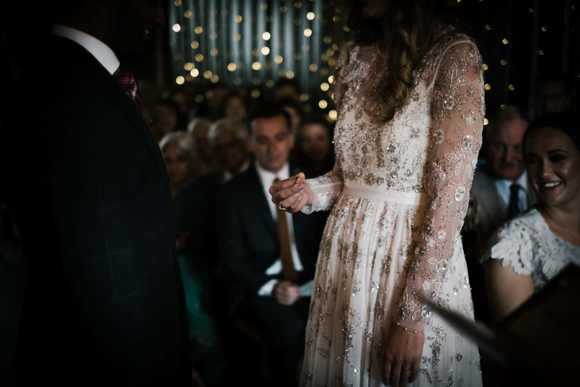 bride holds ring at Owen house barn wedding