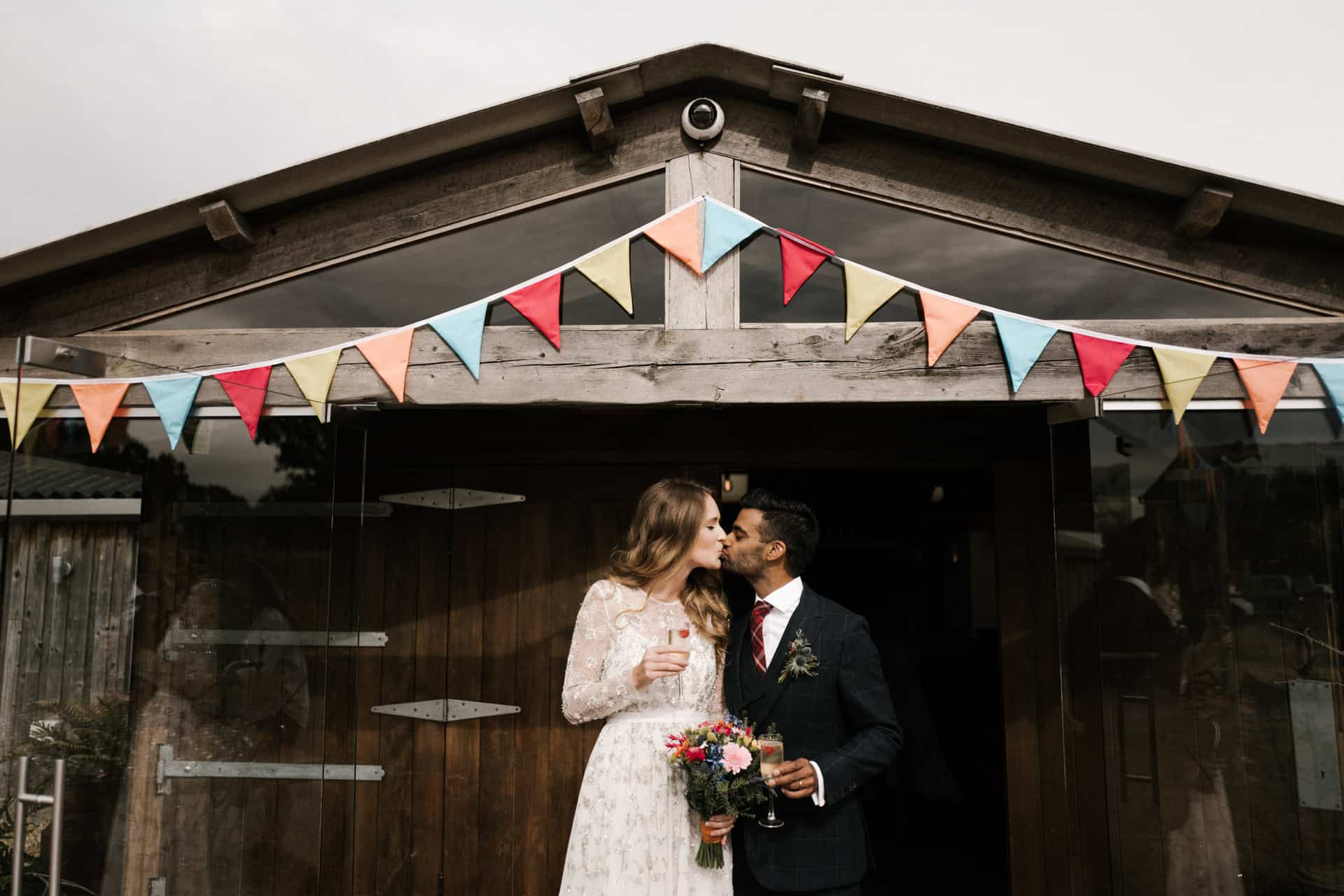 bride and groom first kiss at Owen House barn wedding