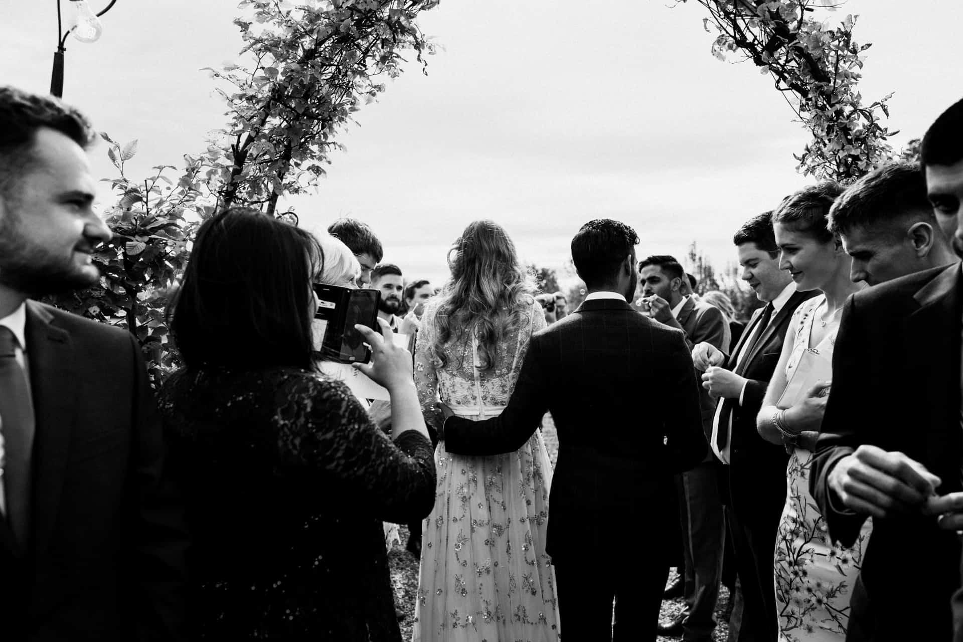 bride and groom confetti shot at Owen House barn wedding