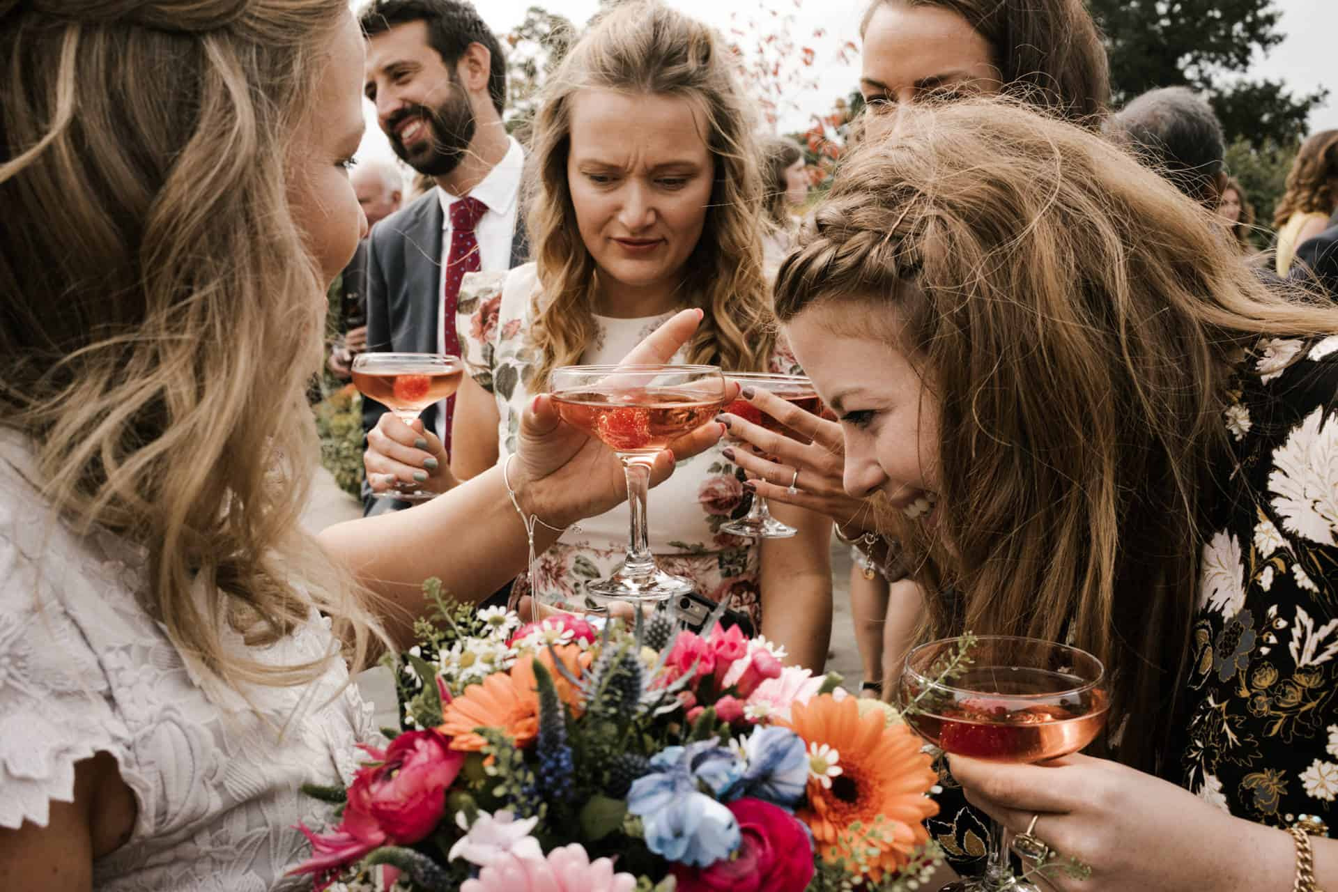 girls drinking cocktails at owen house wedding barn
