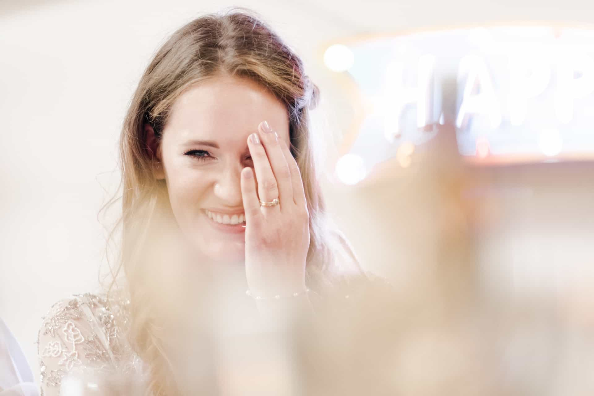 bride laughs during speeches