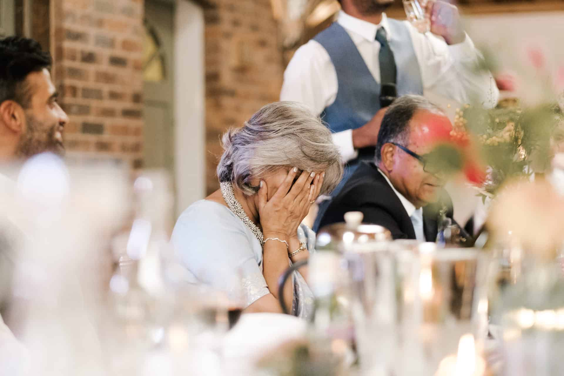 mother laughs during speeches