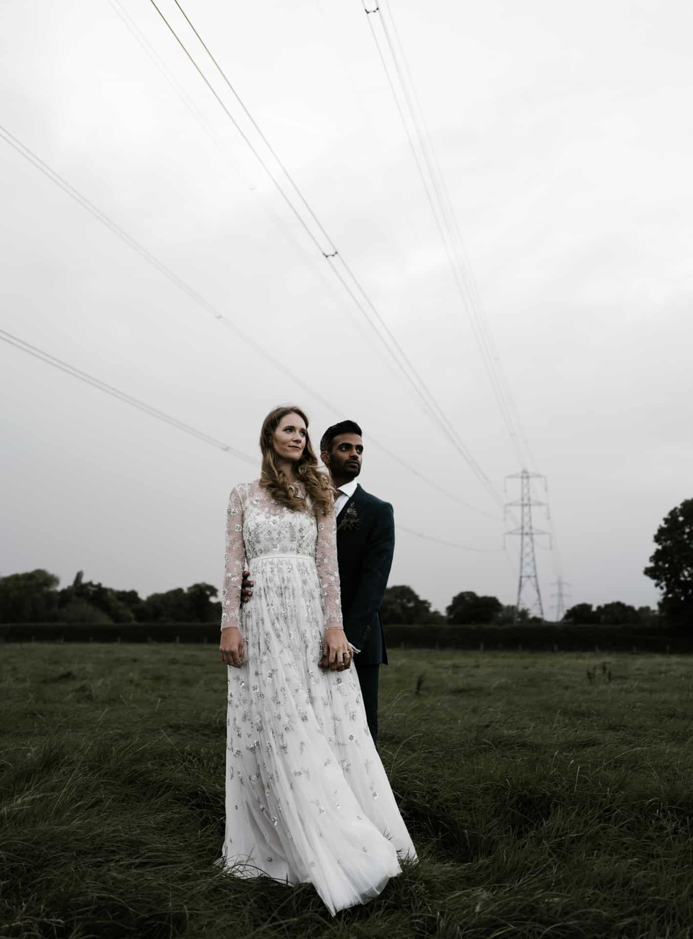 bride and groom shot in a field