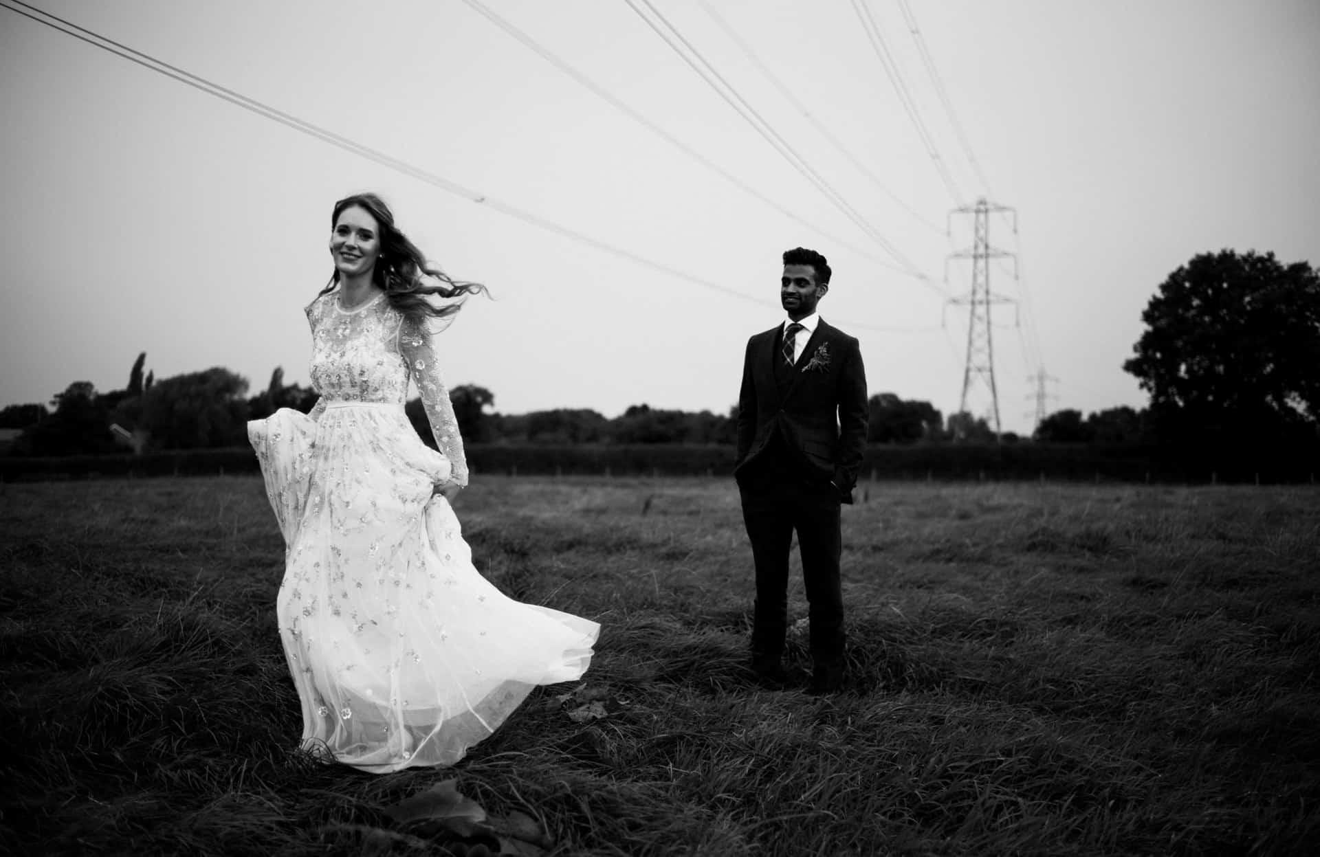bride twirling her dress in a field