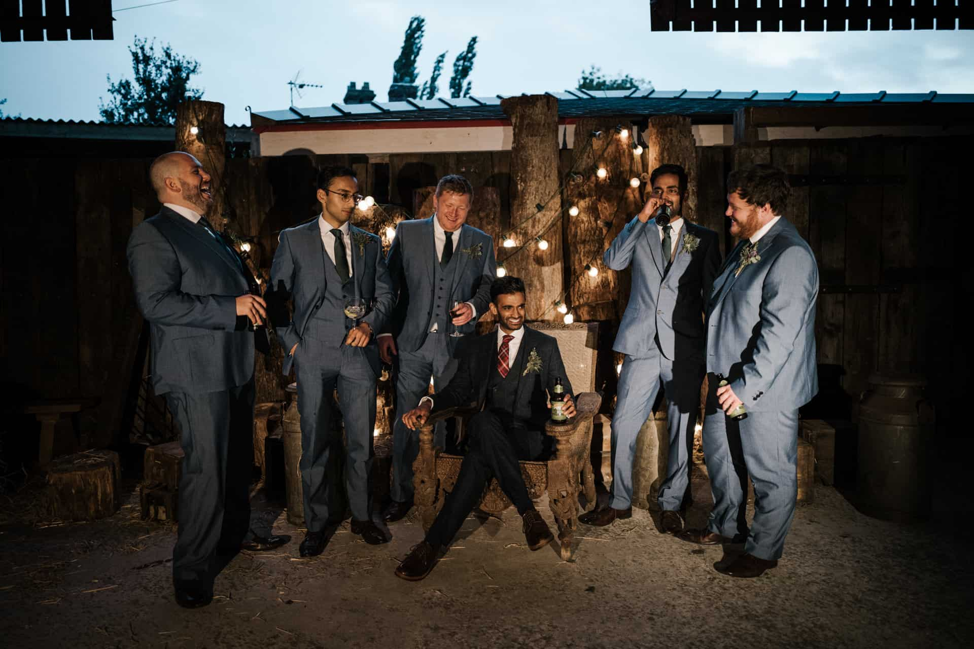 groomsmen shot at bridesmaids shot at Owen house barn wedding