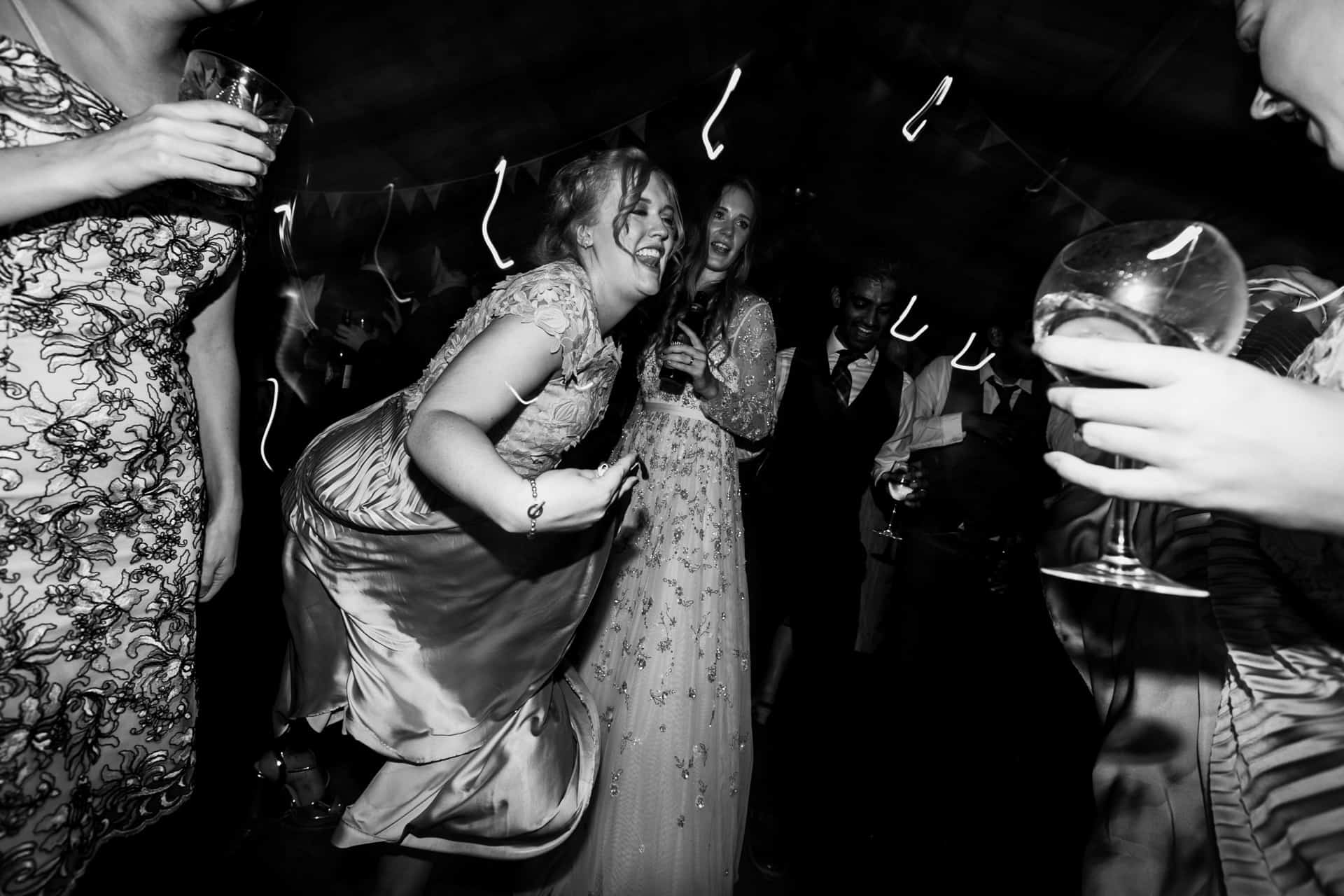 bride and bridesmaids on the dancefloor