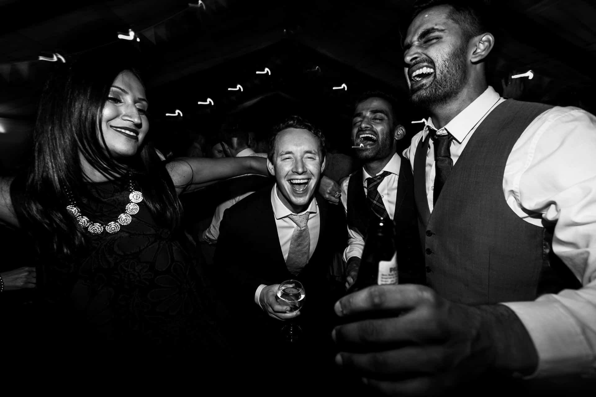 boys on the dancefloor at Owen House barn wedding