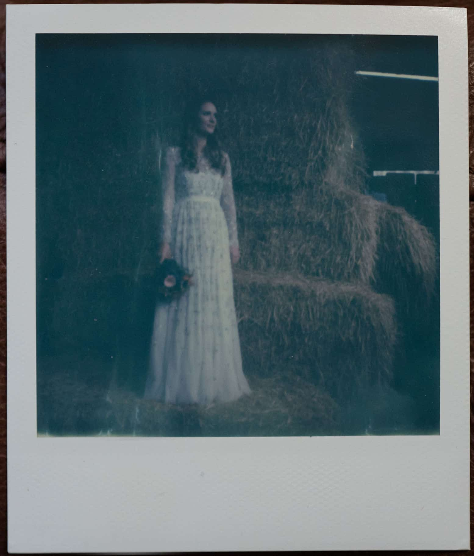 Polaroid shot of bride at Owen House barn wedding