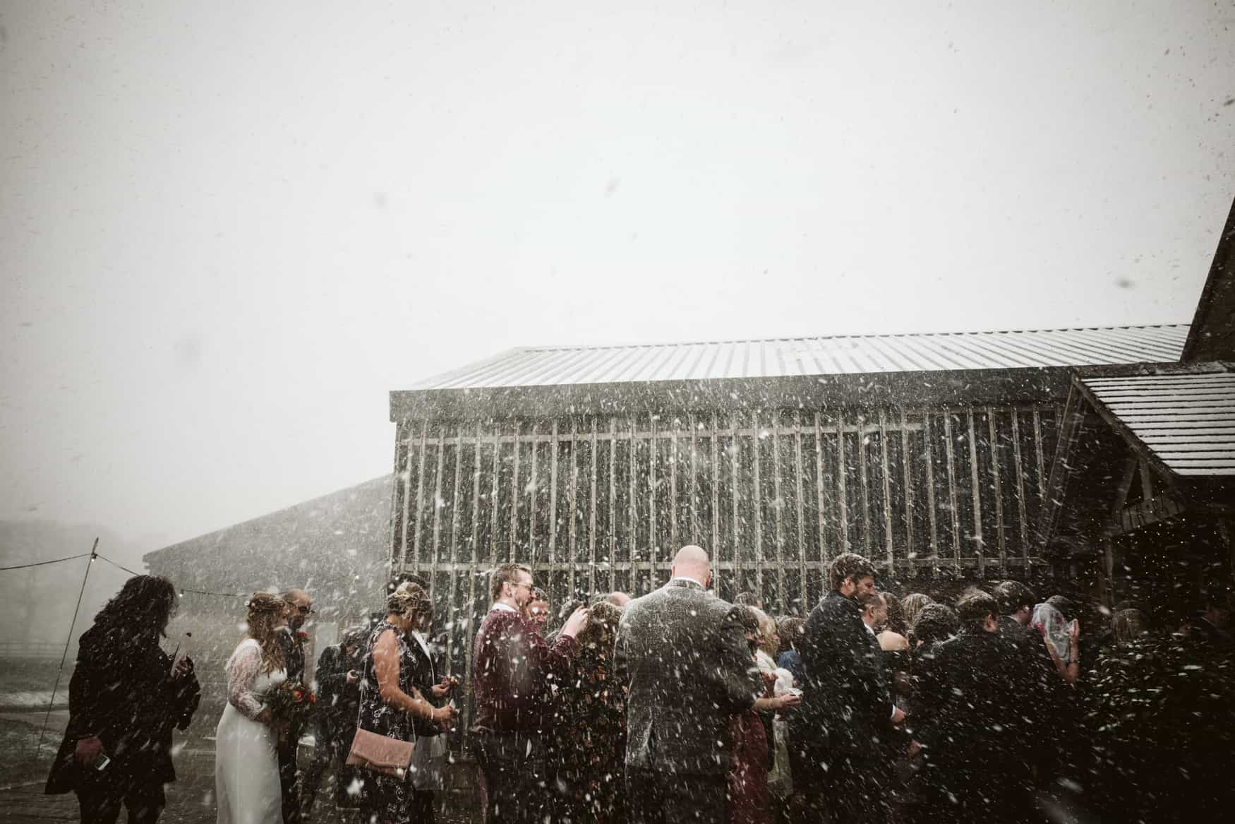 wedding guest covered in snow