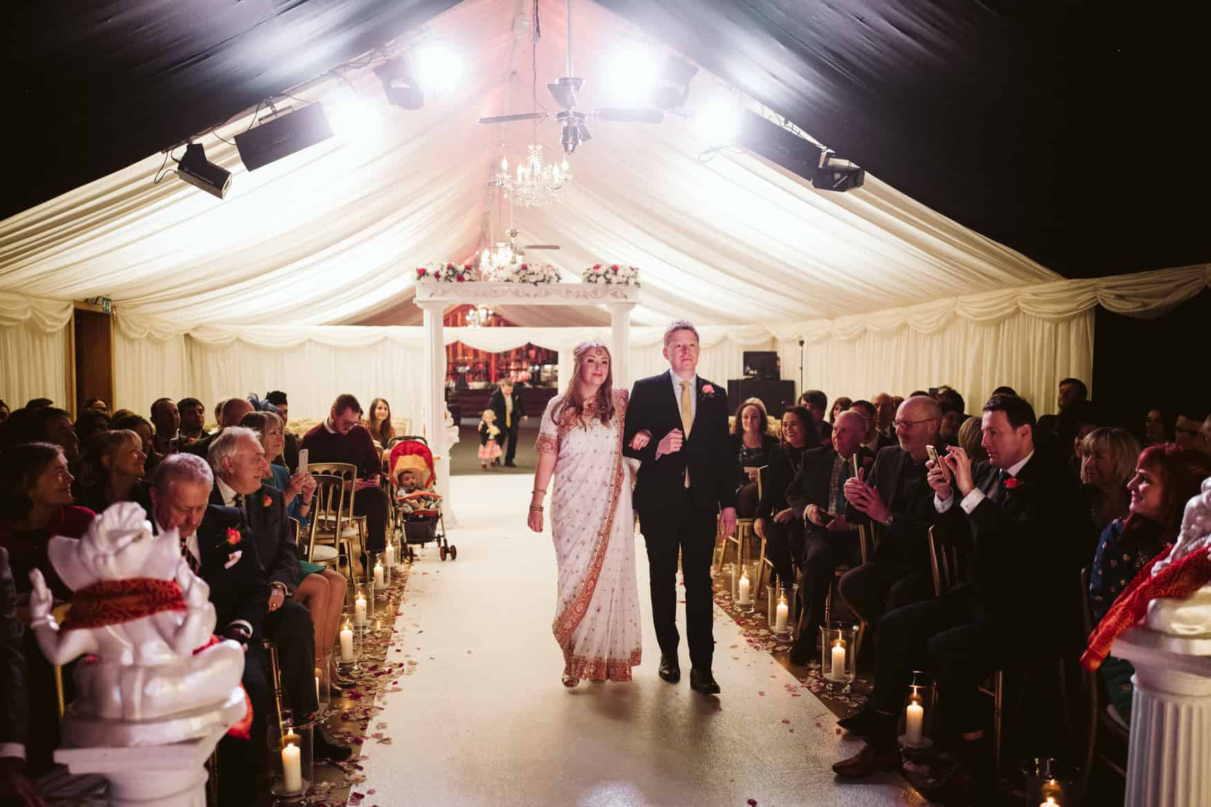 bride walks to meet groom at Hindu ceremony