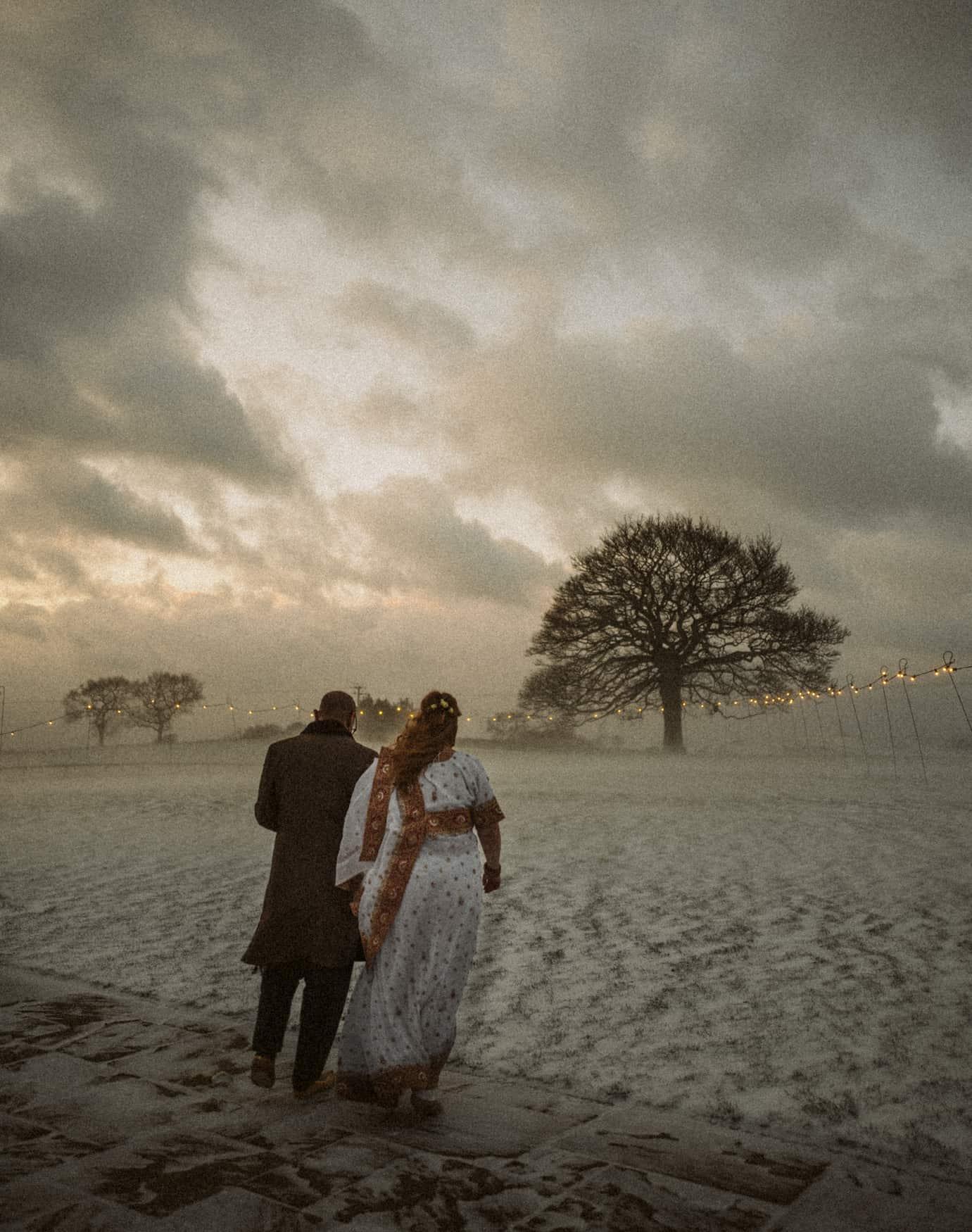 Bride & groom portrait in snow