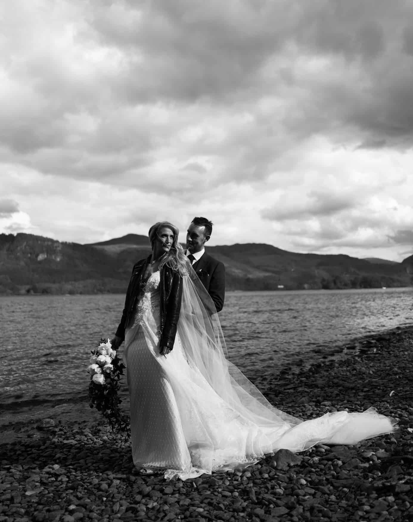 bride and groom portrait by th in black and white