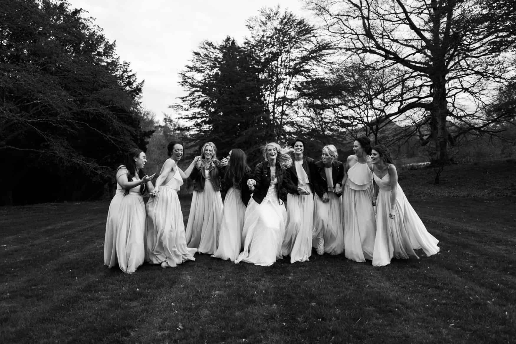 bridesmaids in a field being silly
