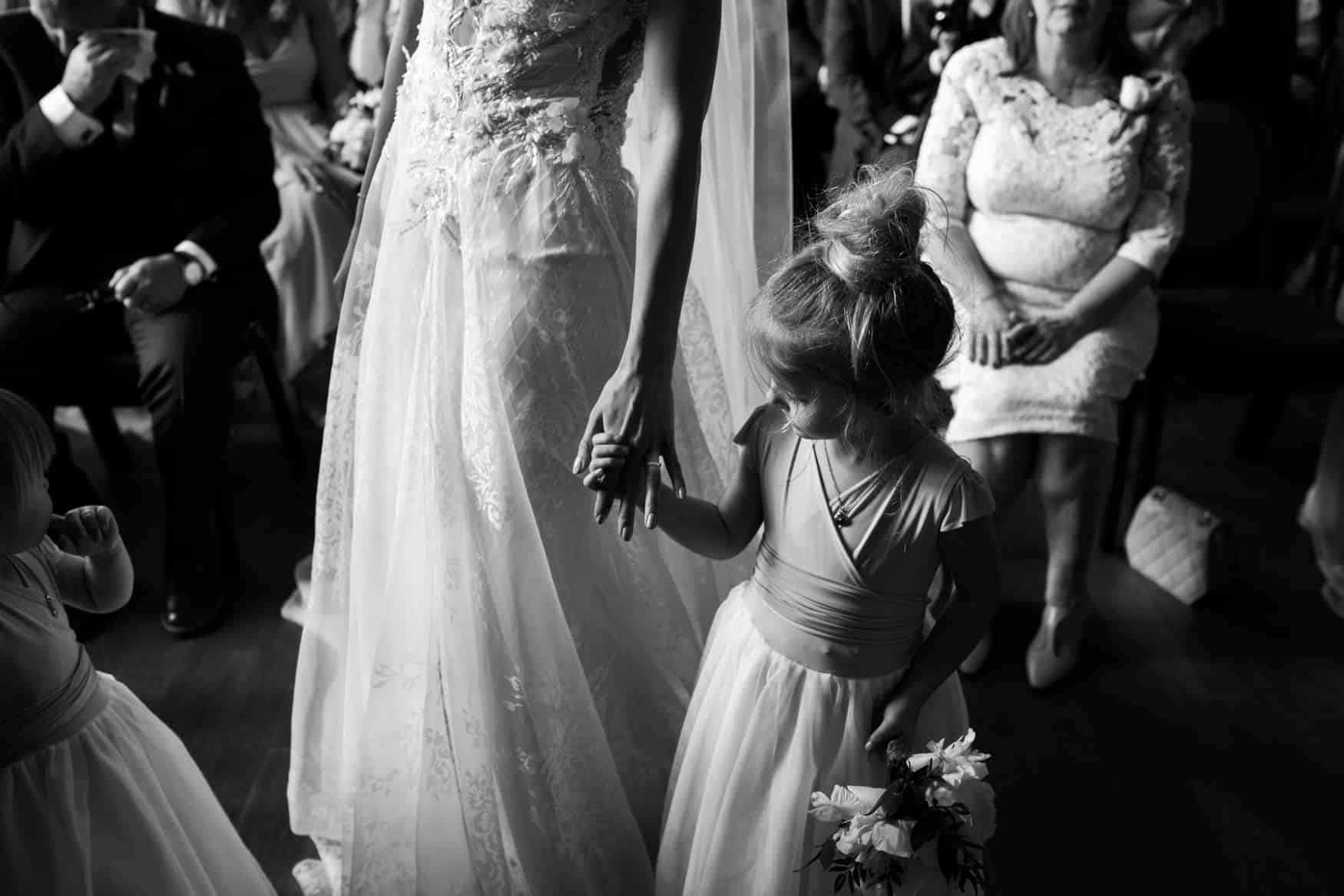 flower girl checks out mums ring