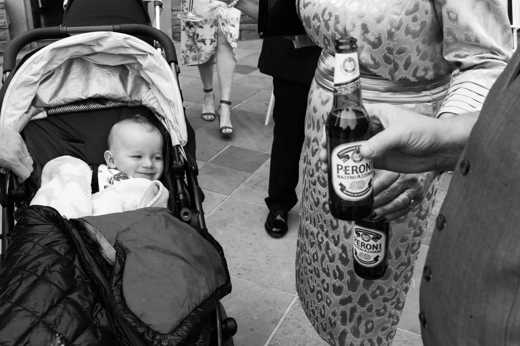 baby eyes up beer