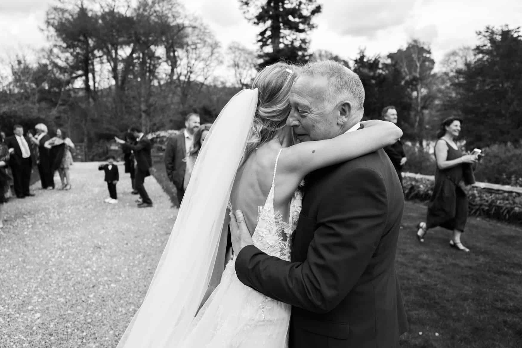 bride and dad hug