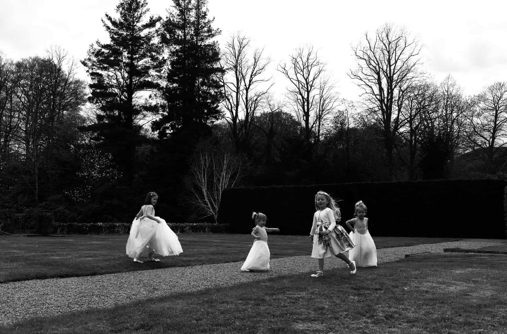 flower girls playing in a field