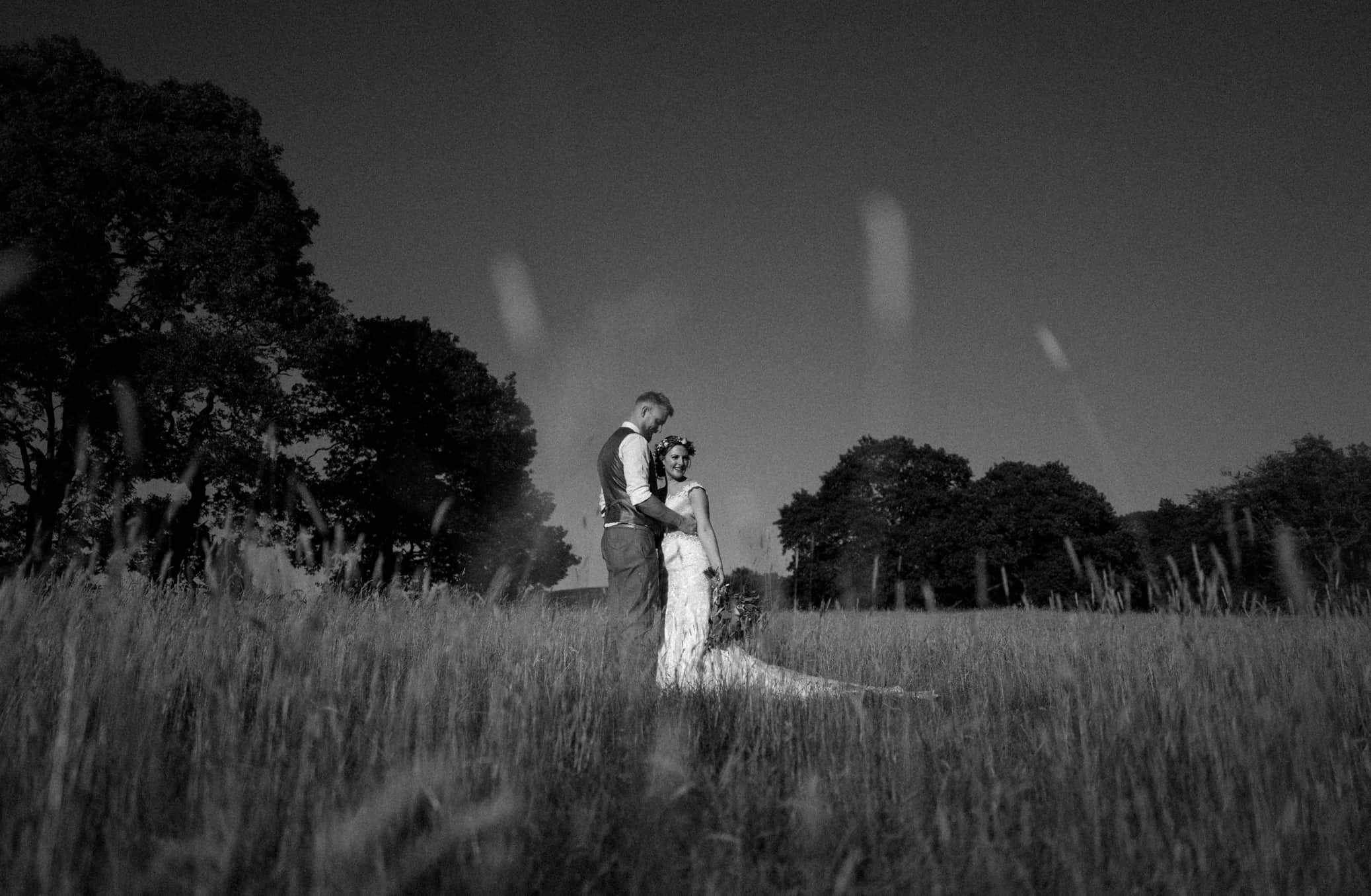 bride and groom in love in a field